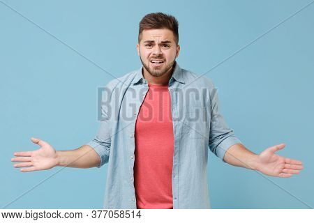 Perplexed Bewildered Young Bearded Guy 20s In Casual Shirt Posing Isolated On Pastel Blue Background