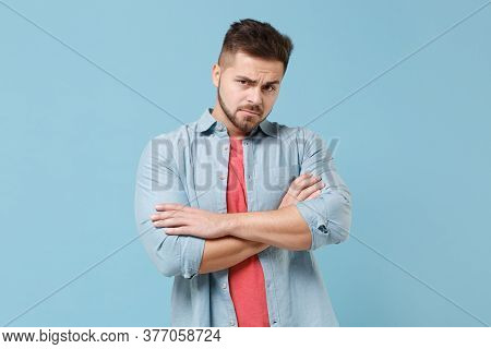 Displeased Puzzled Young Bearded Guy 20s In Casual Shirt Posing Isolated On Pastel Blue Wall Backgro