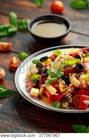 Antipasto Salad With Pasta, Tomato, Olives, Red Onion, Bell Pepper, Salami, Cheese, Artichoke And Ba