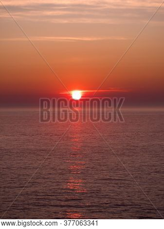 Wonderful Orange And Red Sunset Over The Sea.  Pointe-au-père Is Located In The Administrative Regio