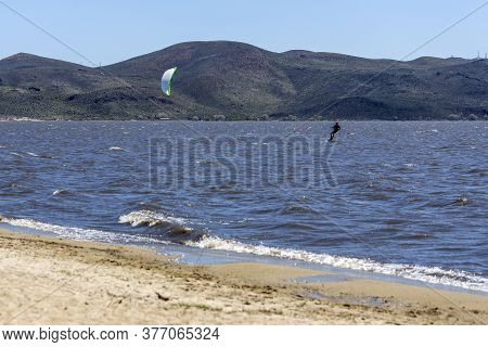 Kiteboarder On A Windy Day Out In The Water At Washoe Lake
