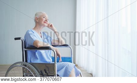 Happy Disabled Old Female Senior Elderly Patient Woman On Wheelchair In Hospital Ward Room In Medica