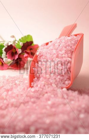 A Scoop Of Cleansing Pink Bath Salts To Add To Your Hygiene Routine.