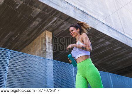 Spanish Woman Running Outdoors. Sport Concept.