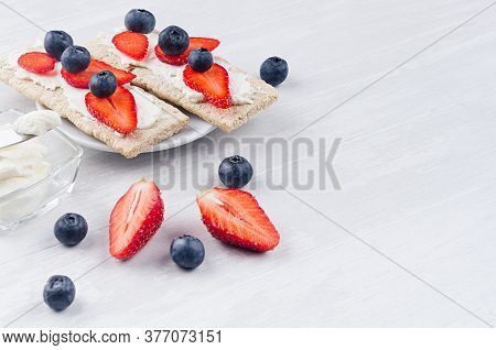 Fresh Spring Vitamine Sandwiches Of Flat Cereal Rye Dry Crisps Bread With Ripe Strawberry Slices, Bl