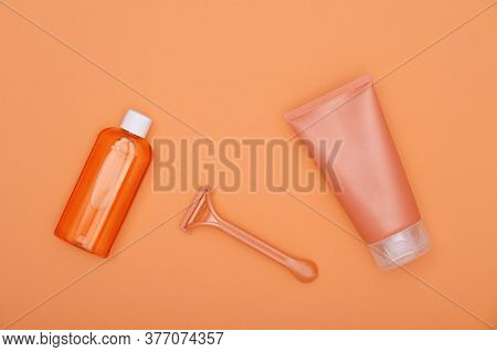 Close Up Feminine Beauty Care Flat Lay Of Shaving Set On Orange Background, Elevated Top View, Direc