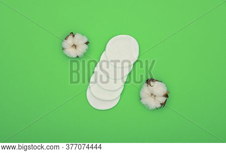 Close Up Feminine Hygiene And Beauty Care Flat Lay Of White Makeup Sponges And Cotton Flowers Over G