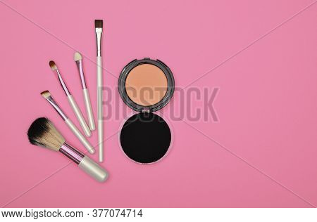 Close Up Set Of Face Makeup Blush, Beige Sponge And Brush Over Pink Background, Elevated Top View, D