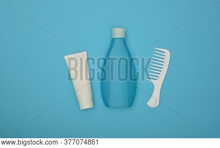 Close Up One Bottle Of Shower Gel Or Shampoo, Conditioner Or Lotion And Hair Comb Over Blue Backgrou