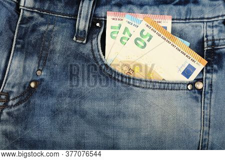 Close Up Several Euro Paper Currency Banknotes In Jeans Front Pocket, Low Angle View