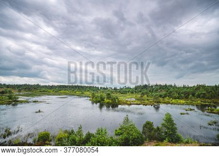 Wetland With Small Lakes And Green Wilderness Under A Dark Sky