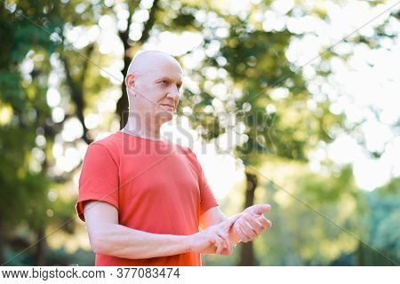 Old Man Measuring Heart Rate Pulse On His Wrist