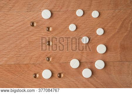 Number Nineteen Laid Out From Tablets Of Various Shapes On A Wooden Board