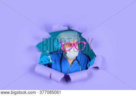 Vaccination For People. Vaccination. Doctor In Big Glasses With Syringe Looking Through Paper. Injec