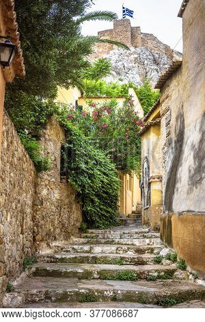 Plaka District In Athens, Greece. Narrow Street With Vintage Stairs And Old Houses, Traditional Alle