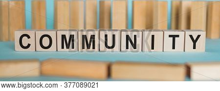 Community Word Written On Wood Block. Community Text On Blue Table With Wood Background For Your Des