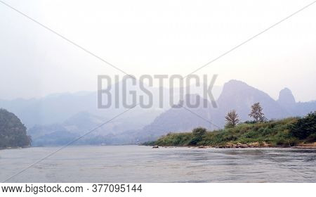 Beautiful morning landscape with mountains and river Mekong near to Luang Prabang, Laos, Asia