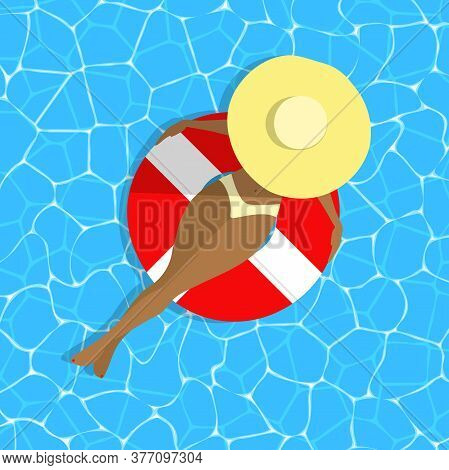 Woman On Swimming Ring Concept. Tanned Girl In A Hat Top View On Blue Water Background. Relaxing Cha