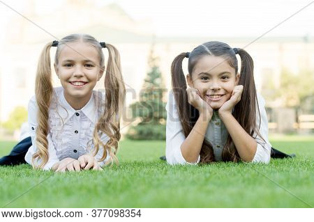 Beauty Is Whatever Gives Joy. Happy Kids Relax On Green Grass. Beauty Look Of Little Girls. Childs S