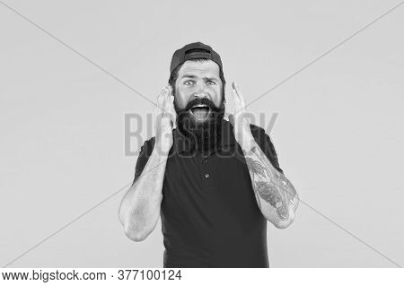 Surprised Of Rapid Beard Growth. Bearded Man Open Mouth With Surprise Yellow Background. Hipster Wit