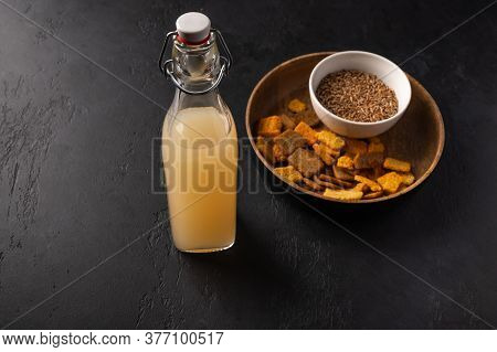 Homemade Tradishional Russian Light Rye Kvass In Bottle And Crackers On Dark Wooden Background. Sele