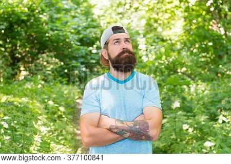 Away From City. Man Hipster Hiking. Male Beard Care. Brutal Hipster In Forest. Discover New Places.