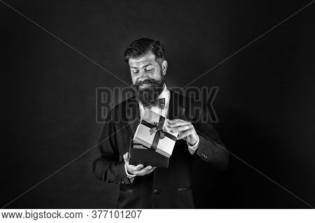 Not For Sale. Happy Boss Hold Present Box Dark Background. Happy Man Getting Gift. Happy Holidays. H