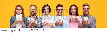 Group Of Optimistic Modern Young People In Casual Clothes Holding Piggy Banks Of Different Colors An