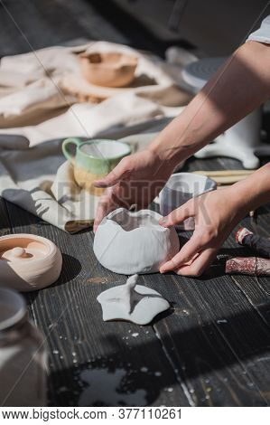 Female Potter Making Ceramic Dishes At Her Studio. Working Process Of Glazing Ceramic Bowl.