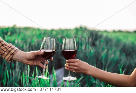 Two Hands With Wine Glasses. Wine Glasses.