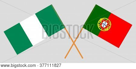Crossed Flags Of Nigeria And Portugal. Official Colors. Correct Proportion. Vector Illustration