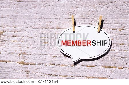 Membership On A White Sheet With Wooden Pins