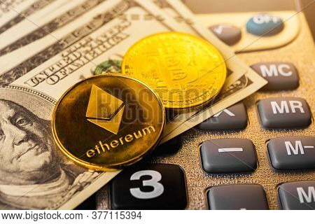 Golden Ether Coins Or Ethereum Network Exchange On Calculator And 100 Dollars, Blockchain And Money