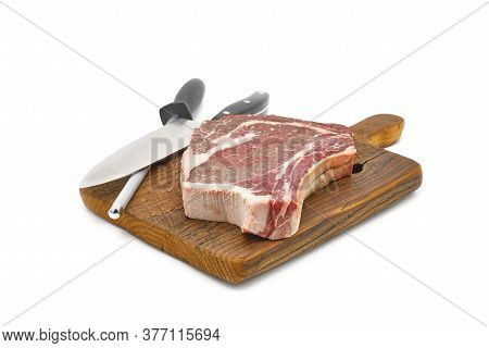 Photograph Of An Aged Aaa Angus Rib Streak On A Vintage Cutting Board Photographed On A White Backgr