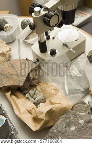 A Geologist's Worktable With Ore Samples Ready To Be Assayed