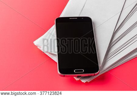 Smartphone With Blank Screen On Top Of Mail Envelopes Top View Business Concept