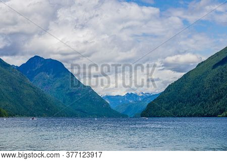 Blue Mountain Lake With Green Mountains Blue Sky And White Clouds