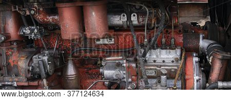 Old Diesel Tractor Engine Close-up Panorama, Red And Rusty