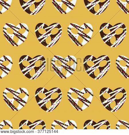 Chocolate Covered Simple Pretzel Seamless Pattern On Yellow Background Design