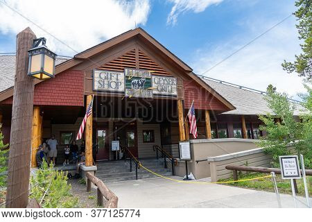 Yellowstone National Park, Wyoming - June 27, 2020: The Old Faithful Snow Lodge Gift Shop And Geyser