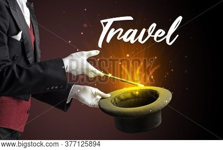 Magician is showing magic trick with Travel inscription, traveling concept