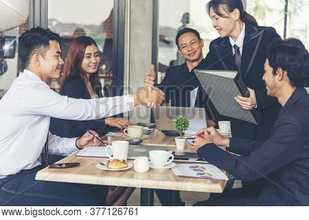 Team Business Partners Shaking Hands Together To Greeting Start Up Small Business In Meeting Room. S