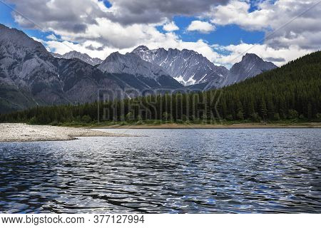 Lower Kananaskis Lake With The Rocky Mountains In The Background During Canadian Travel.