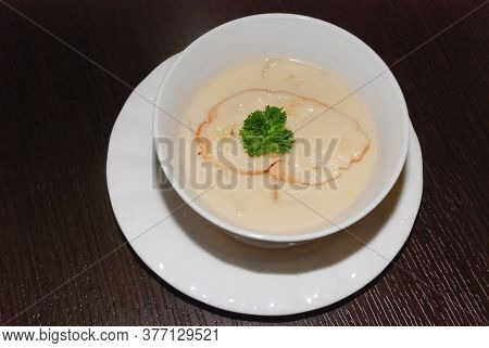 Creamy Mushroom Soup In The White Bowl . Top View