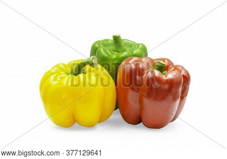 Three Colors Sweet Bell Pepper On White Isolated Background With Clipping Path. Yellow, Green And Re