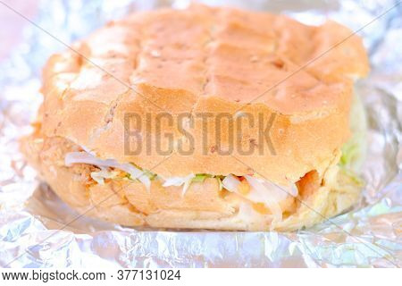 Doner Kebab Sandwich With Fresh Meat And Vegetables On Aluminum Foil. High Quality Photo