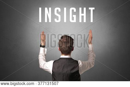 Rear view of a businessman with INSIGHT inscription, powerfull business concept