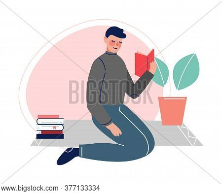 Guy Sitting On The Floor And Reading A Book, Male College Or University Student, Young Man Spending