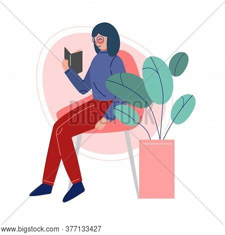 Girl Sitting On A Chair And Reading A Book, Female College Or University Student, Young Woman Enjoyi