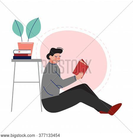 Guy Sitting On The Floor And Reading A Book, Male College Or University Student, Young Man Enjoying
